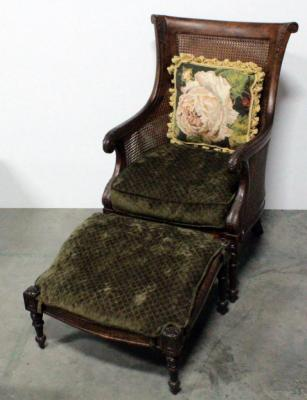 Carved Wood Arm Chair With Wicker Back And Padded Seat, Tilted Foot Stool And Floral Design Throw Pillos