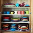 Fiesta Ware Assortment Including Plates, Bowls, Saucers, Dessert Dishes, Tea Cups, Platters And More, Contents Of Cabinet