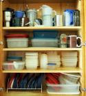 Food Storage Containers, Insulated Travel Mugs, Koozies And More Contents Of Cabinet