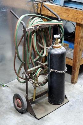 Metal Compressed Gas Tank, Welding Hose And 2 Wheel Tank Cart