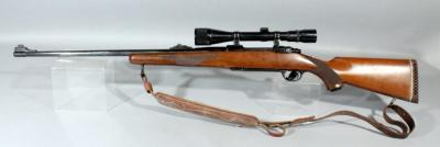Ruger M77 7mm REM MAG Bolt Action Rifle SN# 72-17938 With Scope And Leather Sling