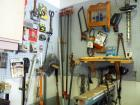 Hand Tool Assortment Including Bar Clamps, Shains, Electric Hedge Trimmer, Steel Tape, Tin Snips And More Contents Of Wall