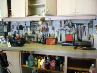 Hand Tool Assortment Including Hammers, Screw Drivers, Wrenches, Drill Bits, Hardware And More Contents Of Top Of Workbench