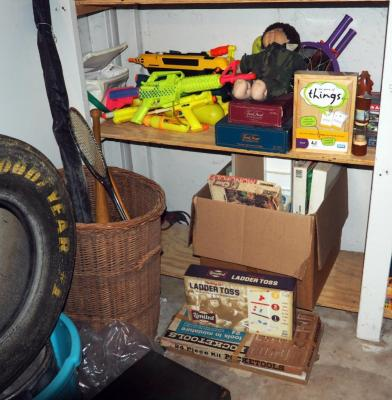 Toy Collection, Including Water Guns, Board Games, Puzzles, Balls, Kite And More, Contents of Two Shelves