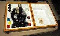 Vintage Tasco Battery Powered Microscope Including Magnification Lenses, Stain, Slides And Wood Carrying Case