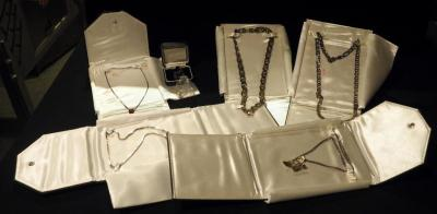 Jewelry Assortment Including 5 Necklaces,3 Motorcycle Charms, And More, Total 8 Pieces