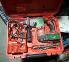 Milwaukee Battery Powered Rotary Hammer With M18 Lithium Battery, Charger, Drill Bits, And Carrying Case