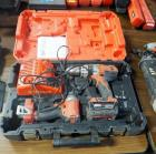 "Milwaukee Battery Powered 1/2"" Hammer Drill, 1/4"" Impact Driver, Battery Charger, Battery, And Carrying Case"
