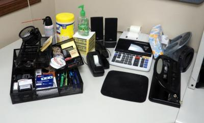 Office Supply Assortment, Including Sharp Adding Machine, Hole Punch, Bulletin Board,Tape Dispenser, Stapler, Pens, Stamps, And More, Contents of Desk