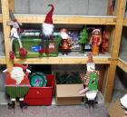 Christmas Decor Including Framed Prints, Santa Clauses, Garland, Yard Stakes And More. Contents Of Two Shelves
