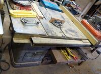 "Delta Unisaw Table Saw With 10"" Blade, Serial No 60-7532; 35"" x 79"" x 31"", Incl Fence, Additional Blades, And Attached Worktable; Misc Hand Tools Not Included, Bidder Responsible For Proper Removal"