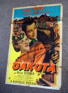 "John Wayne And Vera Ralston In ""Dakota"" Movie Poster (Numbered 40076 R50/404) - 41"" x 27""; And Raiders Of The Lost Ark Marvel Comic Book"