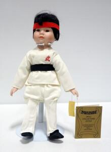 "Seymour Mann Hand-Painted Porcelain Karate Doll On Stand, 14"" Tall"
