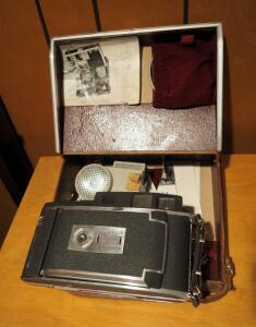 Vintage Polaroid 900 Electric Eye Land Camera Including Flash, User Manual, And Leather Carrying Case