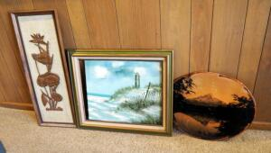 Framed Art Work Assortment Including Lighthouse, Carved Wood Tapestry, And Shellacked Board