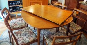 "Mid-Century Modern Solid Wood Dining Table 29"" X 47.25"" X 43.25"" With 2- 23"" Leaves And 6 Matching Upholstered Topped Chairs"