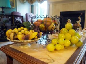 Faux Fruit Decor Including Stone And Wood Grapes, Marble Pedestal Bowl, Wire Basket And More