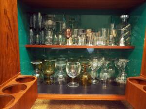 Glass Bar ware Assortment Including Goblets, Wine Glasses, Shot Glasses, Decanter, Beer Glasses And More, Contents Of 2 Shelves