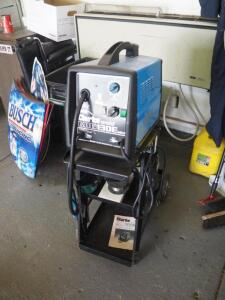 Clarke Weld Gas MIG Welder, Model WE6510, 130E MK2, Includes Firepower Rolling Cart, Compression Tanks, Wire, And Instruction Manual