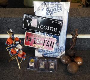"Sports Themed Decor Including Royals Tin Sign, ""Welcome Chiefs Fans"" Sign, Mascot Ornaments, And More; Qty 17 Pieces"