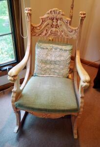 "Antique Carved North Wind Rocking Chair With Upholstered Seat And Throw Pillows, 37"" x 24"" x 34"""