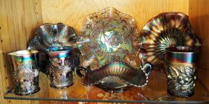 Carnival Glass Assortment Including Juice Glasses, Ruffled Bows, And Handled Dish, Qty 7 Pieces, Contents Of Shelf