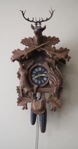 Large Vintage German Wood 8-Day Cuckoo Clock With Stag, Rabbit, And Game Bird Motif