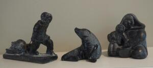 Canadian Soapstone Carvings Including Aardvark Seal, Wolf Original Eskimo And Child, And Jolin Eskimo With Sled