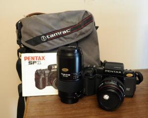 Pentax SF1 35 MM Camera With Tokina Lenses QTY 2 Includes Manual And Carrying Case