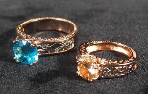 Two Rose Gold Colored Rings, Marked S925, Sizes 10-1/2 And 6, With Blue And Amber Stones