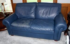 """Leather Center"" Two Cushion Leather Love Seat, 33"" x 70"" x 37.5"" (Wear Present), Matches Lot 43"