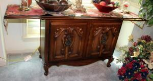 "Drop Leaf 2-Door Sideboard With Scroll Design And Cane Trim 27"" x 60"" x 18"" With Leaves Extended, Contents Not Included"