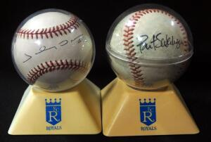 Bret Saberhagen Autographed Baseball And Johnny Damon Autographed Baseball, Both In Kansas City Royals Holders