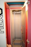 "Hex Level 4 Stand Up Tanning Booth Model 48N5, Includes Dressing Room With T-MAX Timer, Bulbs Replaced In December 2019, Bidder Responsible For Proper Removal, Hardwired To Electrical System, Booth Measures 84"" x 36"" x 36"", Dressing Room Measures 84"" x 43 - 4"