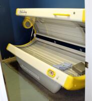 "Sportarredo Holiday 45 Level 3 Tanning Bed With 32 Bulbs, Powers On, Bulbs Replaced In January 2020, 37"" x 82"" x 36"", Bidder Responsible For Proper Removal"