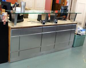"L-Shaped Reception Desk With Glass Counter And Keyboard Tray, 42.75"" x 80"" x 55"", Contents Not Included, Bidder Responsible For Proper Removal"