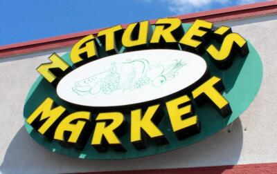 Exterior Nature's Market Electric LED Sign, Approx 5' Tall x 6' Wide, Bidder Responsible For Proper Removal, Mounted To Building Exterior And Wired To Electrical System