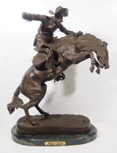 "Frederic Remington (American, 1861-1909), ""Bronco Buster"" Bronze Statue, 24"" High, Marble Base"