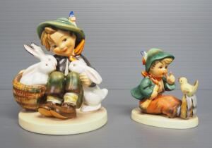 "M I Hummel Figurines Includes ""Playmates"" No. 58, 4.75"" High, Stylized Bee Mark, And ""Singing Lesson"" No. 63, 3"" High, Stylized Bee Mark"