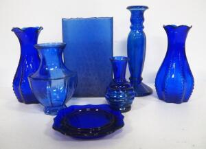 "Blue Glass Flower And Bud Vases, Various Styles, Heights Range 5""-9"" High, And Blue Glass Coaster, Total Qty 7"