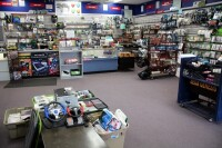 GameCo Video Game Store Contents Selling To One Buyer, Approximately 13,000 Games, Consoles, Accessories, Parts, Action Figures, Apparel, Comics, Posters, Security Cameras, Shelving, Equipment, And More, See Description For More Details - 7