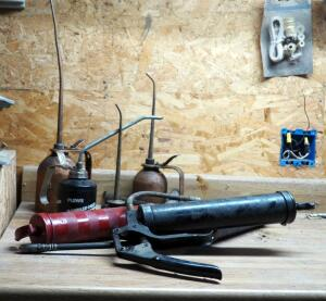 Metal Oiler Cans Qty 4 And Assorted Grease Gun Qty 4
