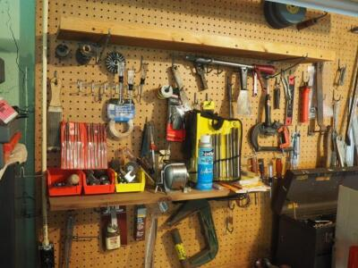 Hand Tool Assortment Including Screwdrivers, Pry Bars, Sanding Wheels, Precision Files, Torque Driver, & Reamer Set, And More; Contents Of Wall