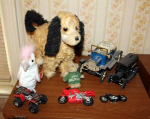 Vintage Battery Operated Mechanical Stuffed Dog, Metal Cars, Model Motorcycles, And Stuffed Animals