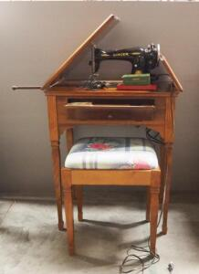 Singer Sewing Machine Circa 1948-1954, In Sewing Table, With Bench, Some Attachments, Needles, And Thread, Powers On (Date Based On Serial Number)
