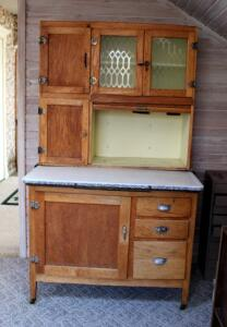 Antique Solid Oak Two Piece Bakers Cabinet With Enamel Ware Slide Out Counter, Frosted Glass Door Panes, Dovetail Construction, & Casters, 69in x 42in x 25in