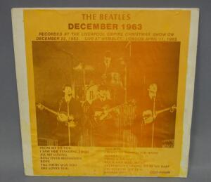 The Beatles Liverpool Empire Christmas Show 12/22/63 and Live At Wembley, London 4/11/65, Unofficial Release, NM Vinyl, Outer Sleeve Has Water Damage