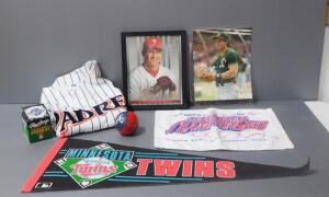 Baseball Collectibles, Includes Autographed Photo Of Jose Conseco, 1995 World Series Ball, Padres Jersey, Atlanta Braves Ball, Twins Pennant, And More