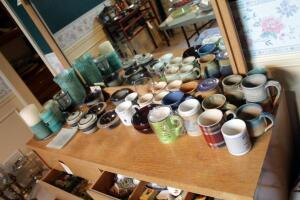 Ceramic And Pottery Coffee Mugs, Marcrest Bowls Qty 2, Pottery Bowls Qty 6, And Candle And Candle Stand Assortment, Contents Of Tabletop