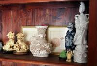 Asian Inspired Collectibles Including, Buddhas, Cinnabar Vase, And More